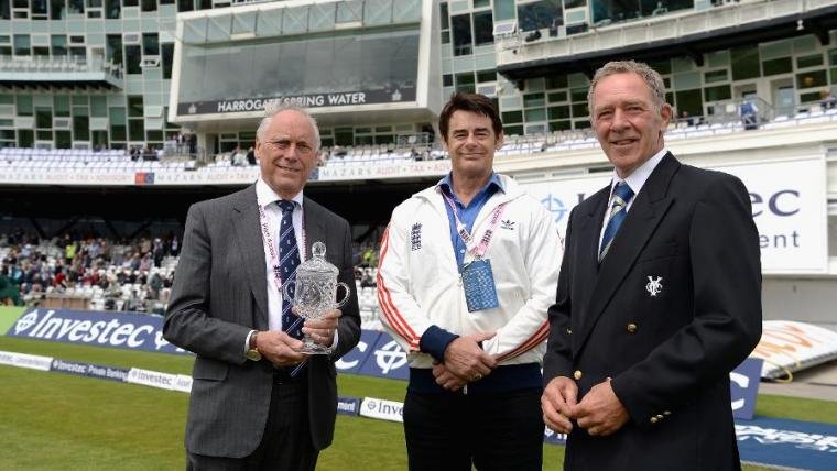 Andy Fogarty being presented with the Groundsman of the Year award by Chris Wood and Colin Graves