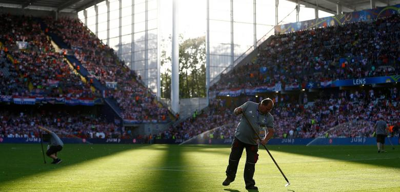 The unseen work of football ground staff, who ensure the grass is always greener